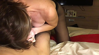 Wife in black pantyhose giving footjob