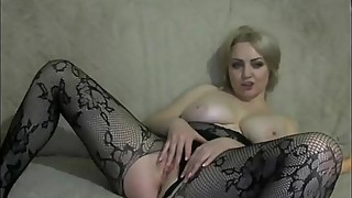 Gorgeous blonde MILF in black tights uses a big dildo